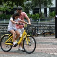 Dad and girl riding bike